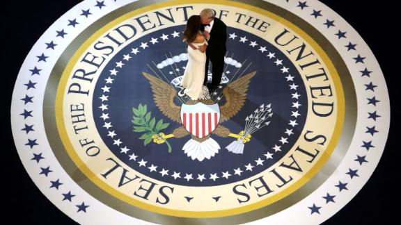 """The new President kisses the first lady as they dance at one of <a href=""""http://www.cnn.com/2017/01/20/politics/gallery/2017-inaugural-balls/"""" target=""""_blank"""">three inaugural balls.</a> The President, known for his affinity of over-the-top gold fixtures, <a href=""""http://www.cnn.com/2017/01/20/politics/inaugural-ball-melania-trump-fashion-2017/"""" target=""""_blank"""">went for classic Americana</a> with a touch of retro glitz."""