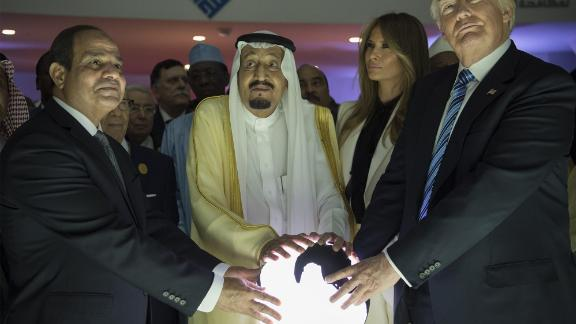 """From right, President Trump, first lady Melania Trump, Saudi King Salman bin Abdulaziz Al Saud and Egyptian President Abdel Fattah el-Sisi attend an inauguration ceremony for the Global Center for Combating Extremist Ideology. The facility is in Riyadh, Saudi Arabia. <a href=""""http://www.cnn.com/2017/05/20/politics/gallery/trump-first-foreign-trip/index.html"""" target=""""_blank"""">See more photos from Trump's first foreign tour in May 2017</a>"""
