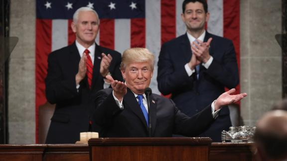 """Trump gestures during <a href=""""https://www.cnn.com/interactive/2018/01/politics/state-of-the-union-cnnphotos/"""" target=""""_blank"""">his State of the Union address</a> in January 2018. Trump declared that the """"state of our union is strong because our people are strong. Together, we are building a safe, strong and proud America."""""""