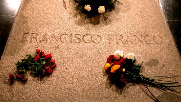 Flower are placed on the tomb of former Spanish dictator Francisco Franco inside the basilica at the the Valley of the Fallen monument near El Escorial, outside Madrid, Friday, Aug. 24, 2018. Spain