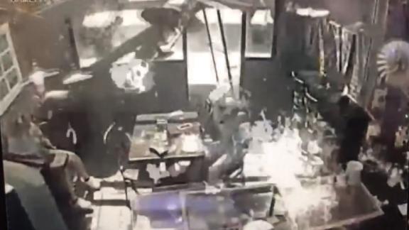 Surveillance video shows coffee shop explosion