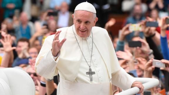 Pope Francis waves to the waiting crowds on College Green, Dublin, Saturday, August 25.