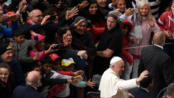 A crowd reacts to Pope Francis' arrival for the Festival of Families.