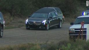John McCain's hearse leaves his home