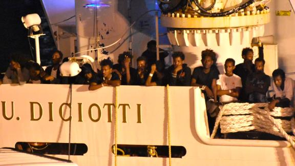 Migrants could be seen waiting to disembark overnight.