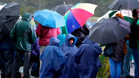 People wait for the arrival of Pope Francis in front of the Knock Shrine on Sunday.
