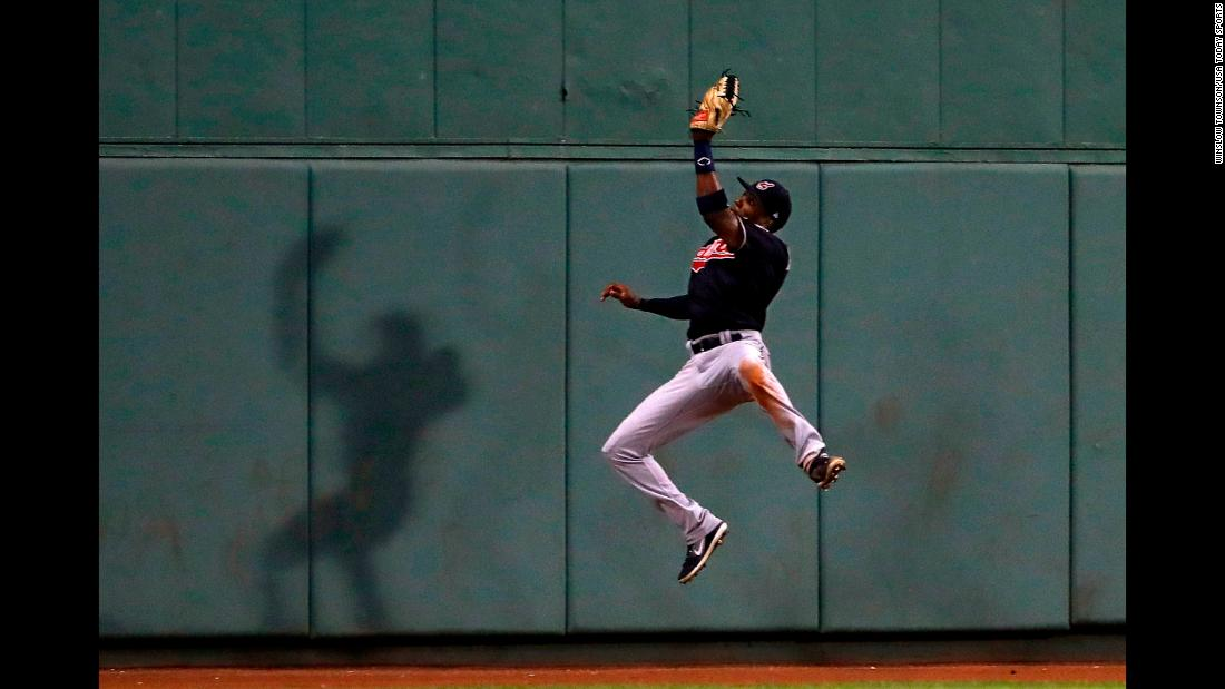 Cleveland's Greg Allen leaps for a catch against Boston on Tuesday, August 21.