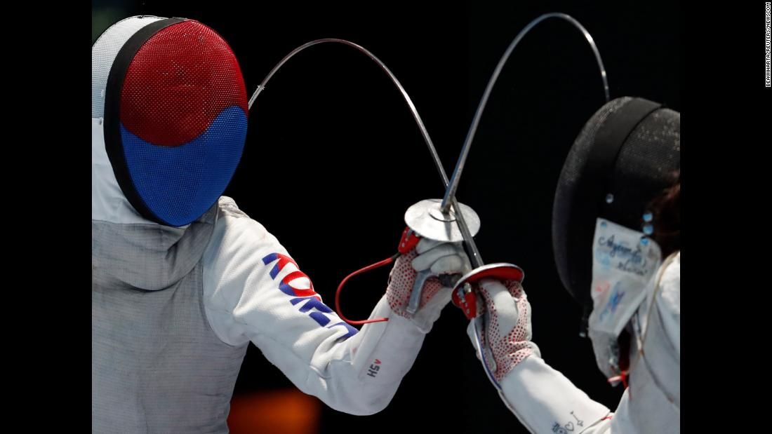 South Korean fencer Jeon Hee-sook, left, competes against Japan's Sera Azuma during the Asian Games on Monday, August 20.