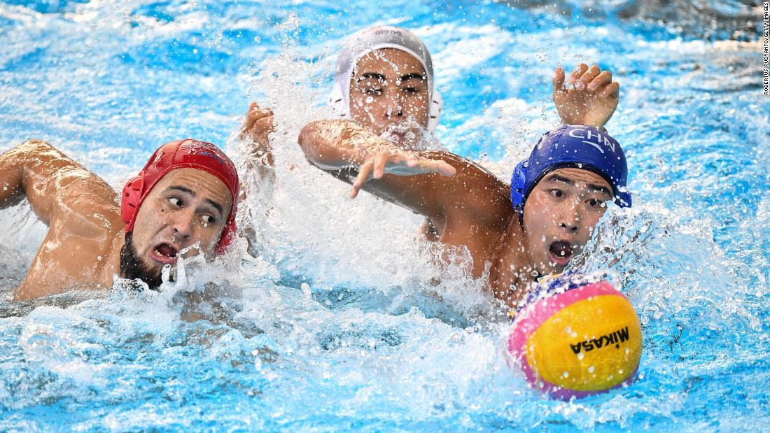 Japan's Katsuyuki Tanamura, left, and China's Liu Xiao swim to the ball during an Asian Games water-polo match on Saturday, August 25.