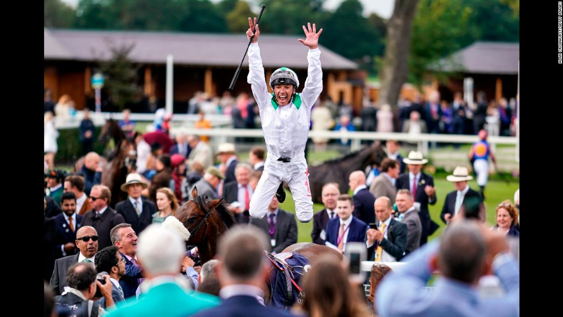 Jockey Frankie Dettori celebrates Friday, August 24, after riding Emaraaty Ana to victory in the Al Basti Equiworld Gimcrack Stakes in York, England.