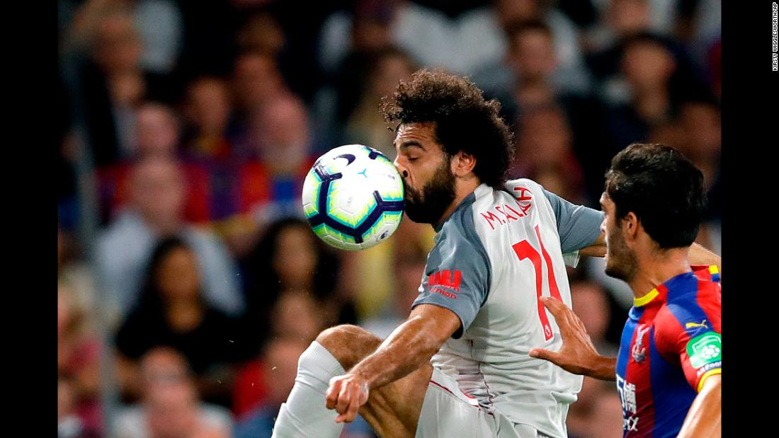The ball smashes into the face of Liverpool's Mohamed Salah during a Premier League match in London on Monday, August 20.
