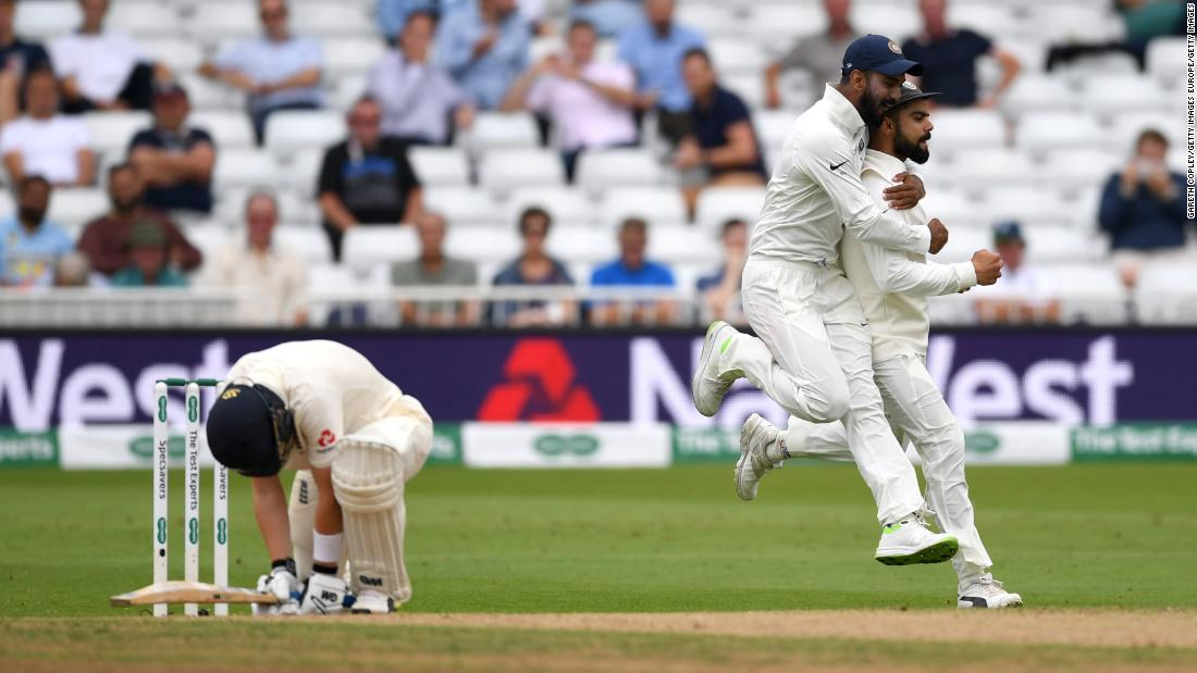 England's Ollie Pope reacts after he was caught out by India's Virat Hohli, right, during a Test match in Nottingham, England, on Tuesday, August 21. India won the match by 203 runs, but England won the other two Test matches they played this month.