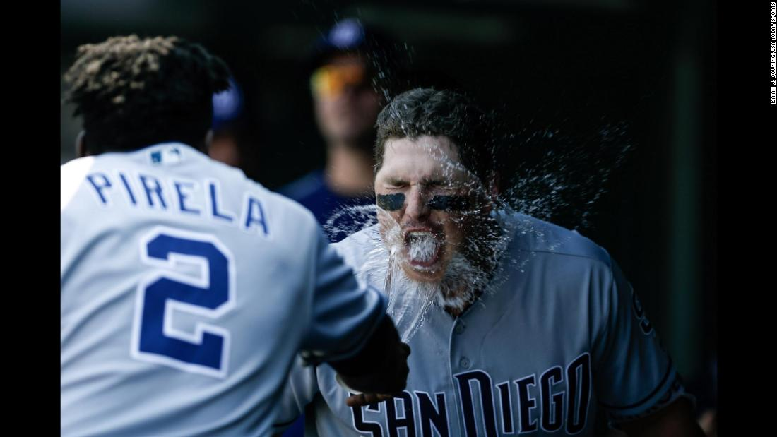 San Diego's Jose Pirela throws water into the face of teammate's Hunter Renfroe after Renfroe hit a home run in Denver on Thursday, August 23.