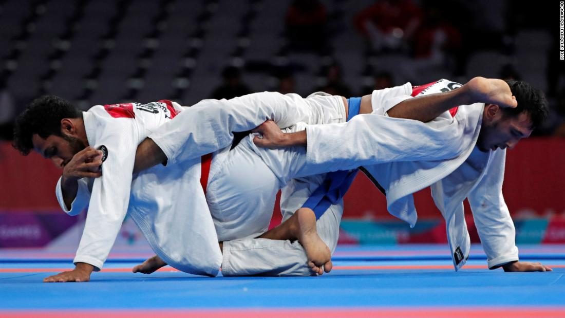 Talib al-Kirbi of the United Arab Emirates competes against Torokan Bagynbai Uulu of Kyrgyzstan in a gold-medal ju-jitsu match at the Asian Games on Friday, August 24. Bagynbai Uulu came out on top.