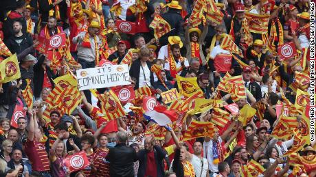 Catalans Dragons fans celebrate historic Challenge Cup victory over Warrington.