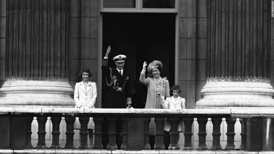 From left, Princess Elizabeth, King George VI, Queen Elizabeth and Princess Margaret wave to the crowd from the balcony of Buckingham Palace on June 22, 1939.
