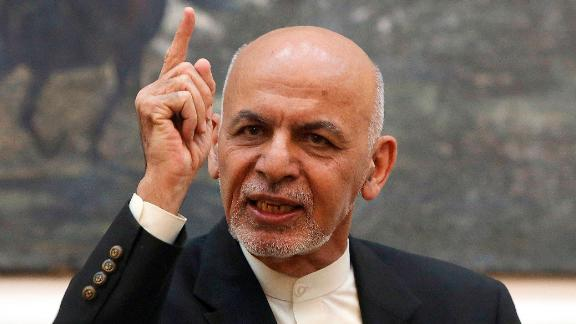 FILE - In this Sunday, July 15, 2018 file photo, Afghan President Ashraf Ghani speaks during a press conference at the presidential palace in Kabul, Afghanistan. Talks next month in Moscow to discuss a peaceful end to 17-years of war in Afghanistan that includes a place at the table for the Taliban has ruffled feathers in Washington and Kabul, who are refusing to attend, and resurrected Cold War memories. (AP Photo/Rahmat Gul)