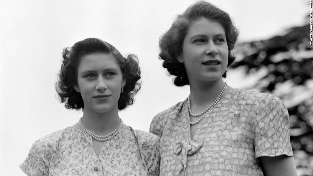 Elizabeth, right, and Princess Margaret wear summer dresses circa 1942. Margaret is Elizabeth's only sibling.