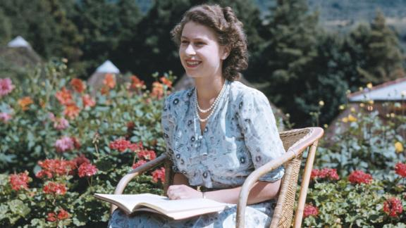 With the Drakensberg Mountains behind her, Princess Elizabeth sits in South Africa's Natal National Park on April 21, 1947. It was her 21st birthday.