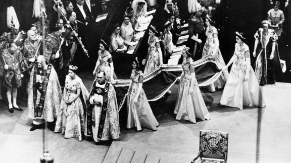 Elizabeth ascended to the throne in February 1952, when her father died of lung cancer at the age of 56. Here, she walks to the altar during her coronation ceremony on June 2, 1953.