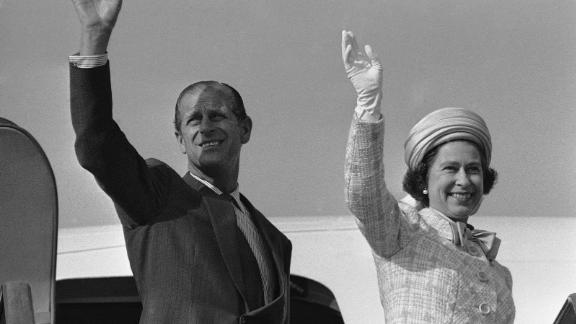The Queen and Prince Philip wave from a plane ramp shortly before taking off from Tokyo in May 1975.