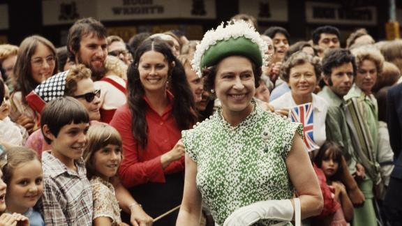 The Queen meets the crowds during her royal tour of New Zealand in 1977.