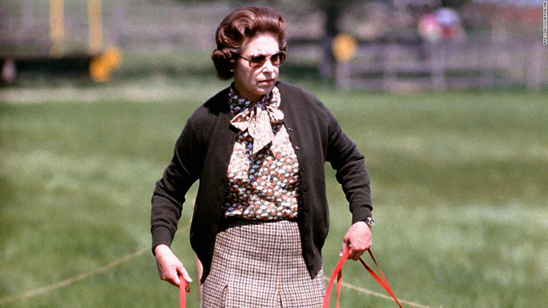 Elizabeth walks with some of her corgis at the Windsor Horse Trials in May 1980.