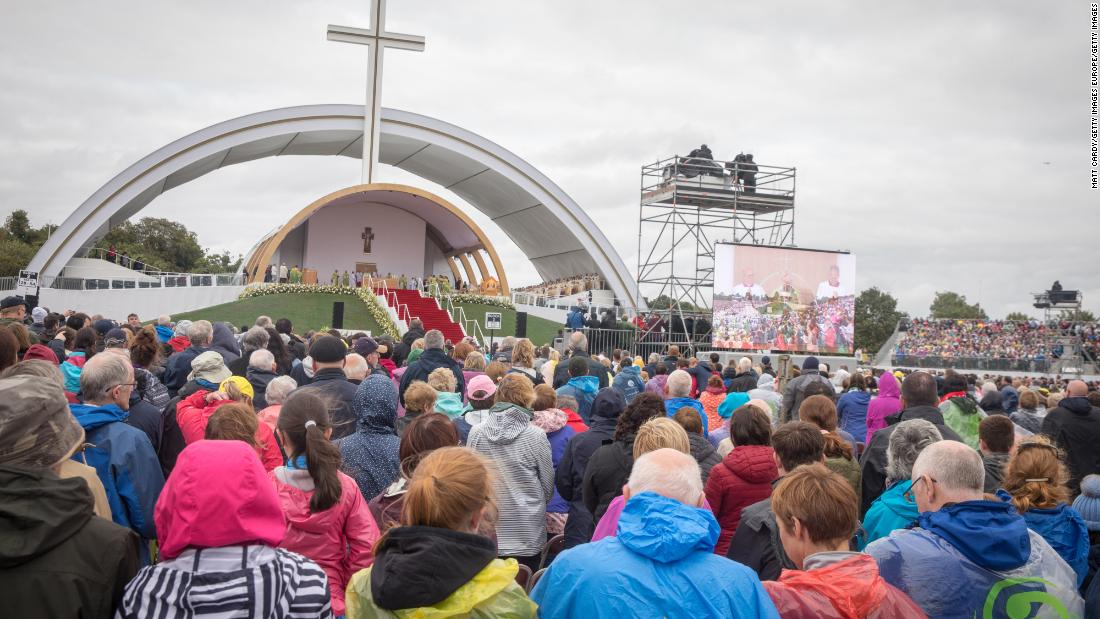 People celebrate Mass in Dublin's Phoenix Park, braving wet and windy weather.
