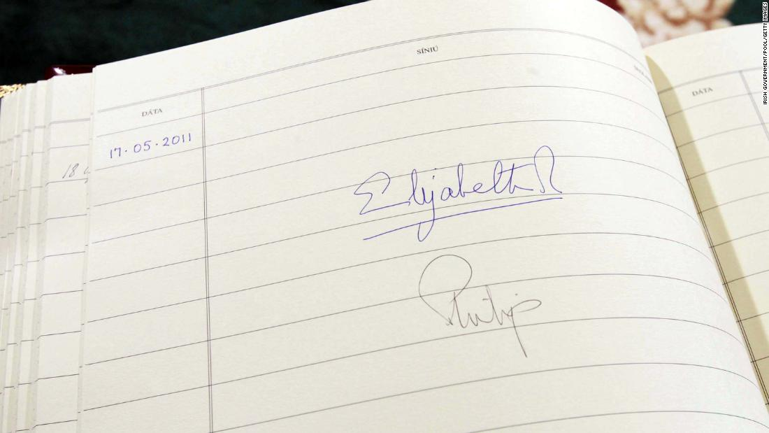 The Queen's signature is seen in the visitors book at Aras An Uachtarain, the Irish President's official residence in Dublin in May 2011.