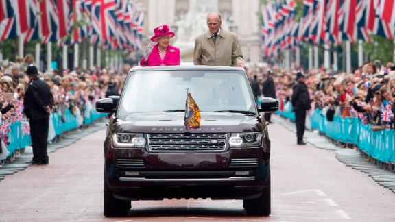 The Queen and Prince Philip wave to guests in London who were attending celebrations for her 90th birthday in 2016.