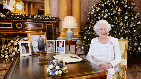 The Queen sits at a desk in Buckingham Palace after recording her Christmas Day broadcast in 2017.