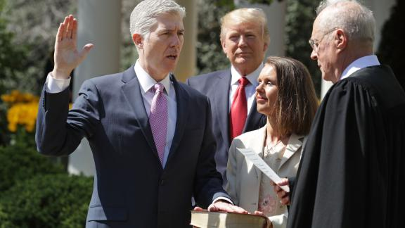 """Trump watches as Supreme Court Justice Anthony Kennedy, right, administers the judicial oath to Neil Gorsuch during <a href=""""http://www.cnn.com/2017/04/10/politics/neil-gorsuch-trump/"""" target=""""_blank"""">a White House ceremony</a> in April 2017. Gorsuch was chosen by Trump to replace Supreme Court Justice Antonin Scalia, who died in 2016. Holding the Bible is Gorsuch's wife, Marie Louise."""