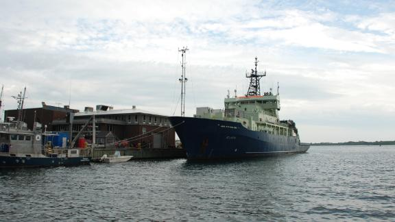 The R/V Atlantis docked at its home port at the Woods Hole Oceanographic Institution in Woods Hole, Massachusetts.
