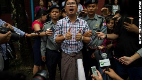 The detained Reuters journalist Wa Lone speaks to journalists after appearing before a trial in Yangon in August 2018.