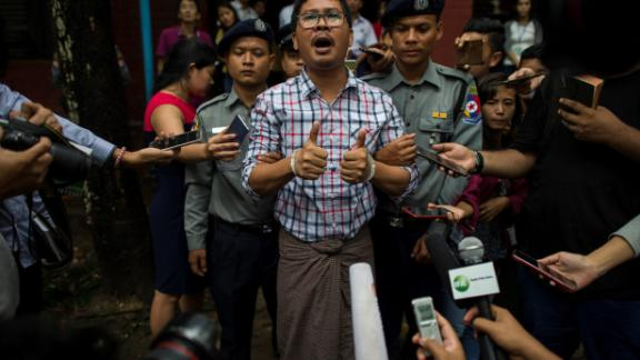 Detained Myanmar journalists Wa Lone speaks to journalist after appearing before a court trial in Yangon on August 20, 2018. - At the time of their arrest Wa Lone, 32, and Kyaw Soe Oo, 28, had been investigating the massacre of 10 Rohingya Muslims in Rakhine a week after militants attacked police posts on August 25, 2017 triggering a brutal response from police and troops. (Photo by YE AUNG THU / AFP)        (Photo credit should read YE AUNG THU/AFP/Getty Images)