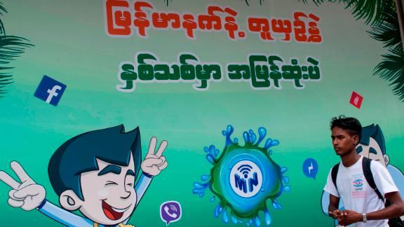 The Facebook logo is seen on an advertisement by a local telecom company in Yangon on June 7, 2018.