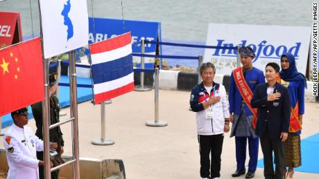 The flag of gold medalists Unified Korea is displayed next to silver medalists China and bronze medalists Thailand during the medals ceremony.