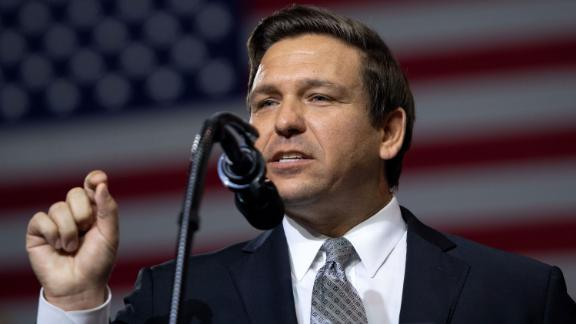US Representative Ron DeSantis, Republican of Florida, and candidate for Florida Governor, speaks during a rally with US President Donald Trump at Florida State Fairgrounds Expo Hall in Tampa, Florida, on July 31, 2018. (Photo by SAUL LOEB / AFP)        (Photo credit should read SAUL LOEB/AFP/Getty Images)