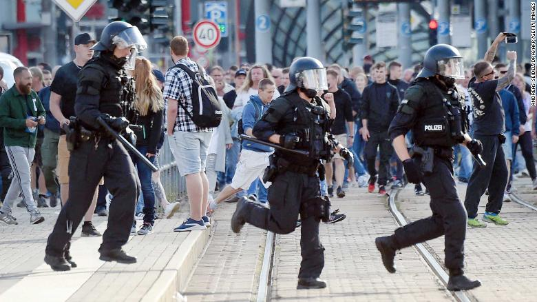 Riot police run in Chemnitz on Sunday as far-right protesters march in the streets.