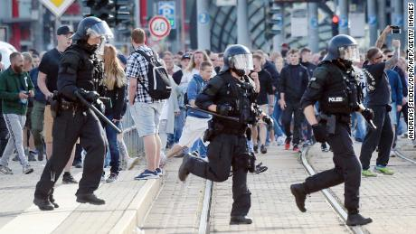 Riot police respond to a spontaneous protest in Chemnitz, eastern Germany, on Sunday.