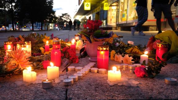 People display candles near the scene of the attack on the 35-year-old man, named by police only as Daniel H.