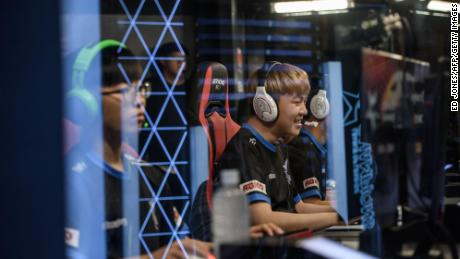 Members of professional eSports team 'Afreeca Freaks' prepare to compete in a 2018 'League of Legends' competition in Seoul.