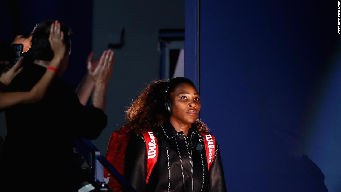 Williams, playing her first home Slam since giving birth to her first child last year, entered the Arthur Ashe Stadium in a black bomber jacket with white trim.