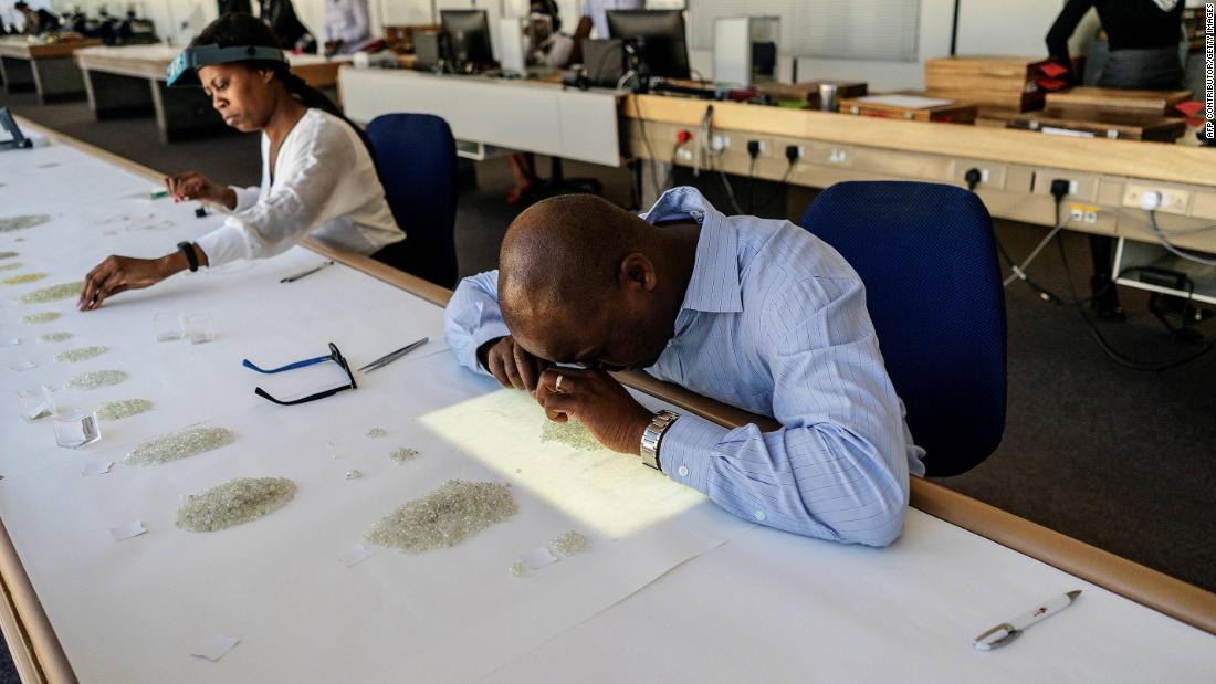 Diamonds are examined and graded by employees at the Namibian Diamonds Trading Company in Namibia's capital, Windhoek.