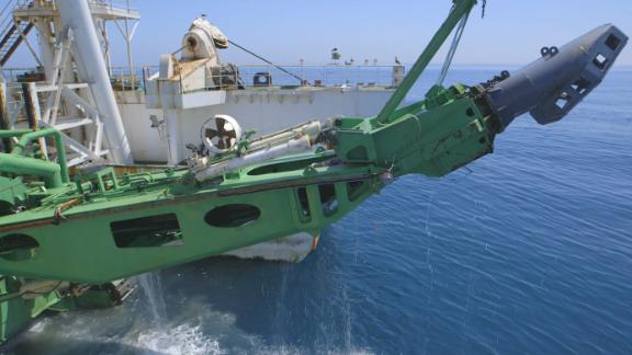 One of the ships has a 280-ton track-mounted crawler that moves in a horizontal arc and mines in lanes.<br />