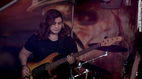 Alma Doumani, the band's bassist.