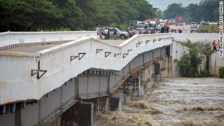 A major bridge along the Yangon-to-Mandalay highway, which connects with Myanmar's capital, Naypyidaw, is seen damaged Wednesday by rampaging floodwaters from a burst dam.