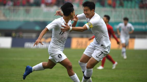 South Korea's Lee Seung-woo (L) celebrates with teammate Son Heung-min (R) after scoring against Vietnam.