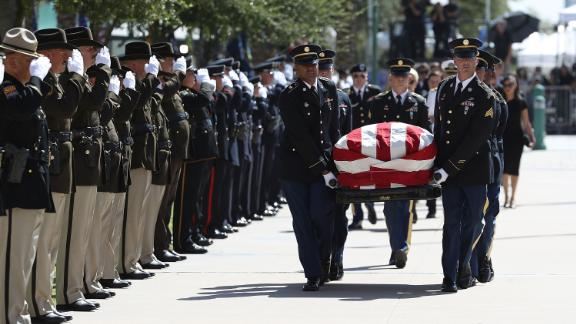 PHOENIX, AZ - AUGUST 29: The casket of U.S. Sen. John McCain (R-AZ) is carried into the Arizona State Capitol on August 29, 2018 in Phoenix, Arizona. U.S. Sen. John McCain will lie in State at the Arizona State Capitol before being transported to Washington D.C. where he will be buried at Arlington National Cemetery. Sen. McCain, a decorated war hero, died August 25 at the age of 81 after a long battle with Glioblastoma, a form of brain cancer.  (Photo by Justin Sullivan/Getty Images)