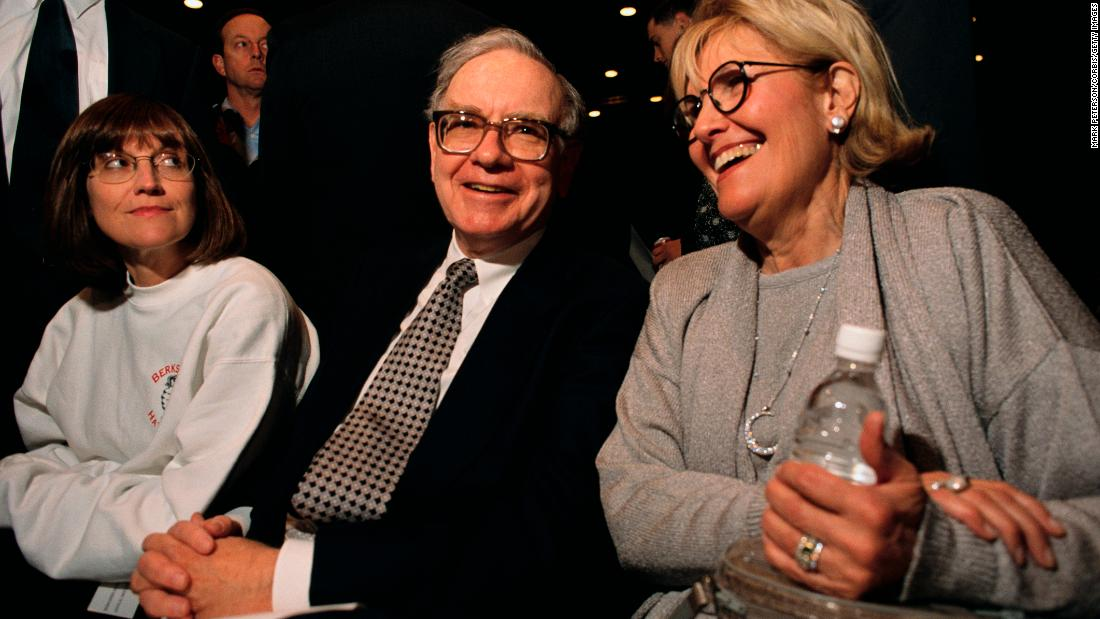 Buffett attends one of Berkshire's annual shareholders meeting. Seated with him here are his daughter Susan, left, and his wife Susan. Buffett's wife died in 2004.